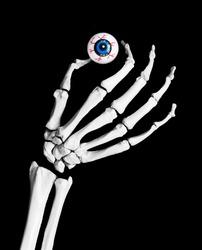 skeleton hand holding an eyeball