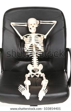 skeleton in an office chair