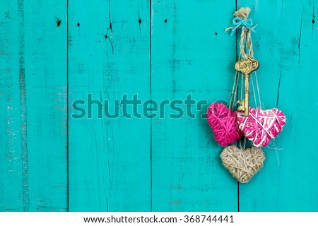 Skeleton Key Pink And Natural Rope Hearts Hanging On Antique Rustic Teal Blue Wood Door