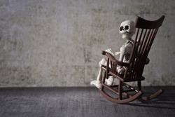 Skeleton looking back while sitting in the rocking chair