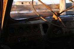 Skeleton of Burnt Car Steering Wheel Old Van Rusty Metal