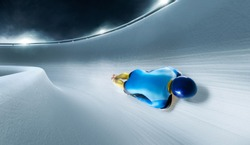 Skeleton sport. Bobsled. The athlete descends on a sleigh on an ice track.  winter sports