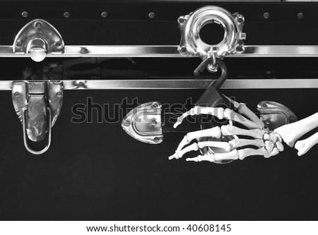 skeleton unlocking a trunk