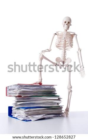 Skeleton with pile of files on white