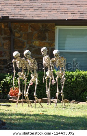 Skeletons and tomb stones decorations for Halloween celebration