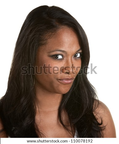 Skeptical African woman with long hair on white background