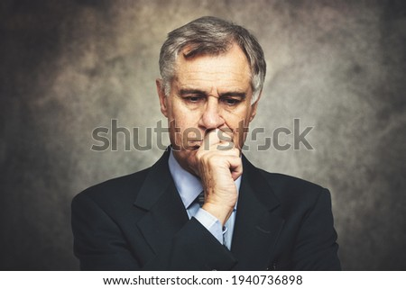 Skeptical businessman portrait on a grungy background Сток-фото ©