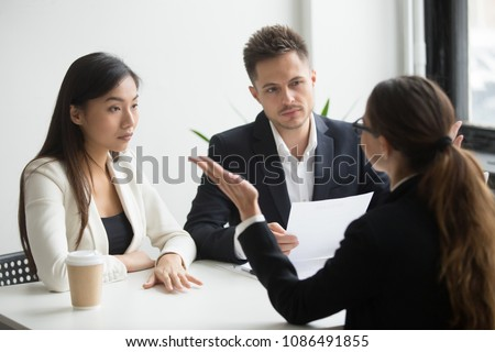 Skeptical unconvinced diverse hr managers interviewing female applicant feeling distrustful doubtful about rejecting vacancy candidate, failed job interview performance, bad first impression concept