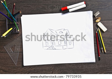 Sketch of housing project on a wooden desk