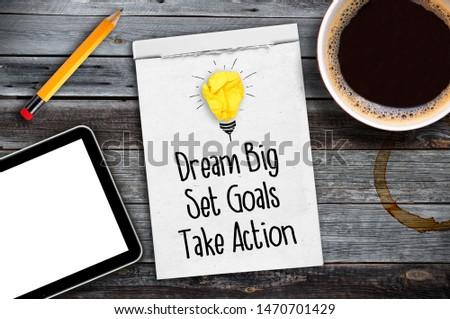 Dream Big - Set Goal - Take Action, handwriting on notebook