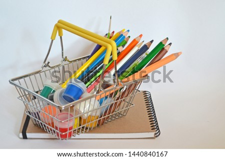 Sketching tutorial. Shopping basket full of supplies for drawing . Paints pencils and album on white background isolated. Art of sketching. Techniques traditional sketching and making sketches. #1440840167
