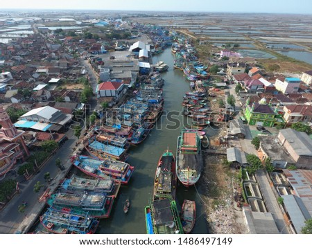 skewed harbor cities and vessels, fishing vessels in Indonesia and Asia. The mouth of the river as a berth #1486497149