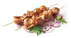 skewers of pork shish kebab isolated on white background, selective focus