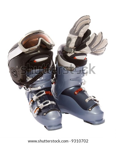 Ski boot's helmet glove and goggles. Isolate on white