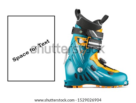 Ski Boots Isolated on White. Yellow Teal Blue Modern Alpine Touring Boot Side View. Snowboarding Protective Gear. Footwear for Skiing. Turquoise Tour Carbon Rear-Entry Ski Boots. Ski Equipment