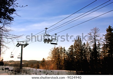 ski cable car at sunset with trees in the background