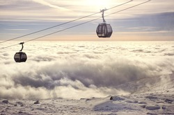 Ski cable car over the valley full of clouds - beautiful nature scenery