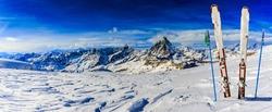 Ski Equipment with panoramic view of Matterhorn on a clear sunny winter day, Zermatt, Switzerland