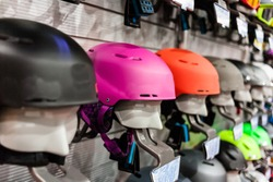 Ski helmet and ski goggles being sold at store. Winter leisure time.