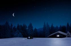 Ski hut at night in winter