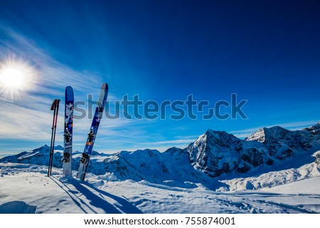 Ski in winter season, mountains and ski touring backcountry equipments on the top of snowy mountains in sunny day. South Tirol, Solda in Italy. #755874001
