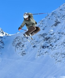 Ski Jumper performing  a tail grab