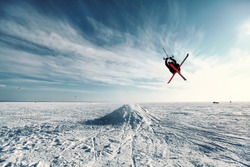 Ski kiting and jumping on a frozen lake