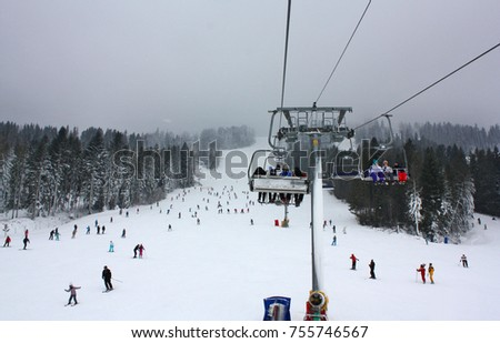 Ski lift in a ski resort on a cloudy day #755746567
