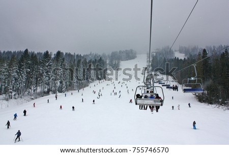 Ski lift in a ski resort on a cloudy day #755746570