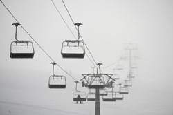 Ski lift in clouds. Chairlift  in Swiss alps in Jungfrauregion in Switzerland