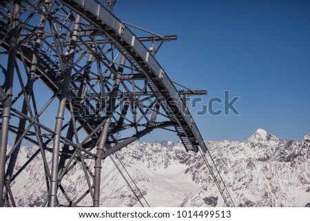 Ski lift in the Alps during skiing season #1014499513