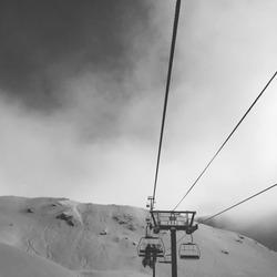 Ski lift into the snow and sky