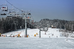 ski lift on ski resort in the snowy mountains