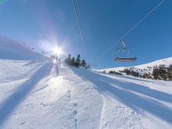 Ski lift on the slope of a big ski resort of Kalavrita in Greece