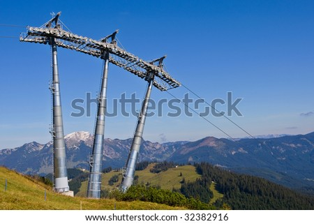 Ski lift tower under high mountains, Gosau Austria