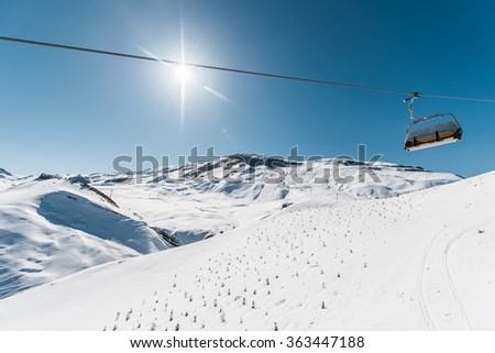Ski lifts durings bright winter day #363447188