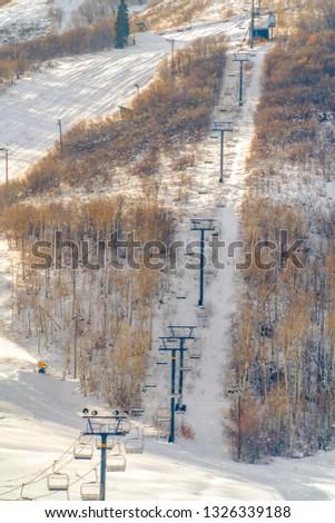 Ski lifts on a ski resort on a sunny day in Utah #1326339188