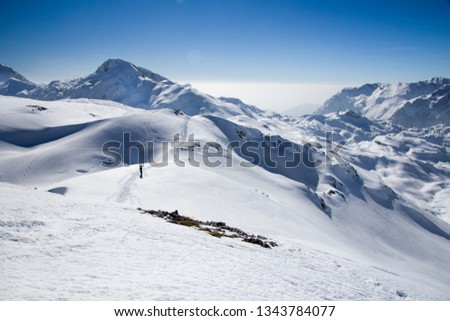 Ski mountainers ascending the mountain on touring skis in fine  weather. Thera are a paradise for tour skiing and snowshoeing. Slovenia, Julian Alps, Komna  #1343784077