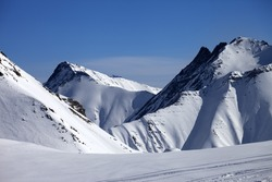 Ski piste at nice winter day. Caucasus Mountains, Georgia, ski resort Gudauri.
