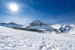 Ski pistes/slopes and mountains background at the Baqueira ski resort, at the Spanish Pirineos