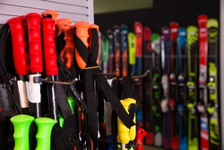 Ski poles for sale in modern store of sports equipment