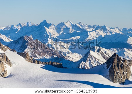 Ski resort  Chamonix Mont Blanc. The mountain is the highest in the Alps and the European Union. Alpine mountains range landscape in beauty French, Italian and Swiss ALPS seen from Aiguille du Midi #554513983