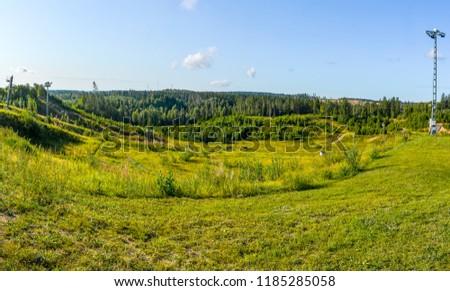"""Ski resort """"Igor"""" in the Leningrad region in the summer.  Summer slopes.  #1185285058"""