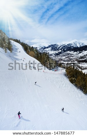 Ski resort in Andorra with skiers sliding down the slope