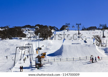 Ski resort winter season mountain slope with people sport skiing and snowboarding day time sunny weather