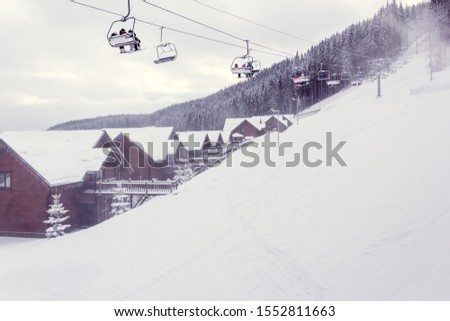 ski resort with city view in winter #1552811663