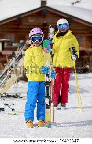 Ski, ski resort, winter sports - family on ski vacation, apres ski