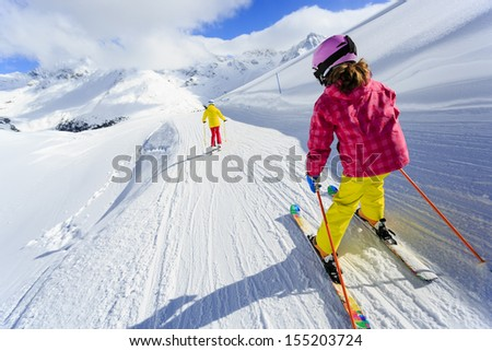 ski  skiers on ski run   child...