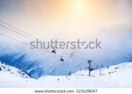 Ski slope and cable car on the ski resort Elbrus. Caucasus, Russian Federation. Winter landscape