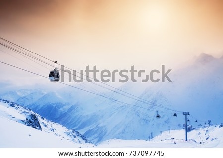 Ski slope and cable car on the ski resort Elbrus. Caucasus, Russian Federation. Winter landscape #737097745